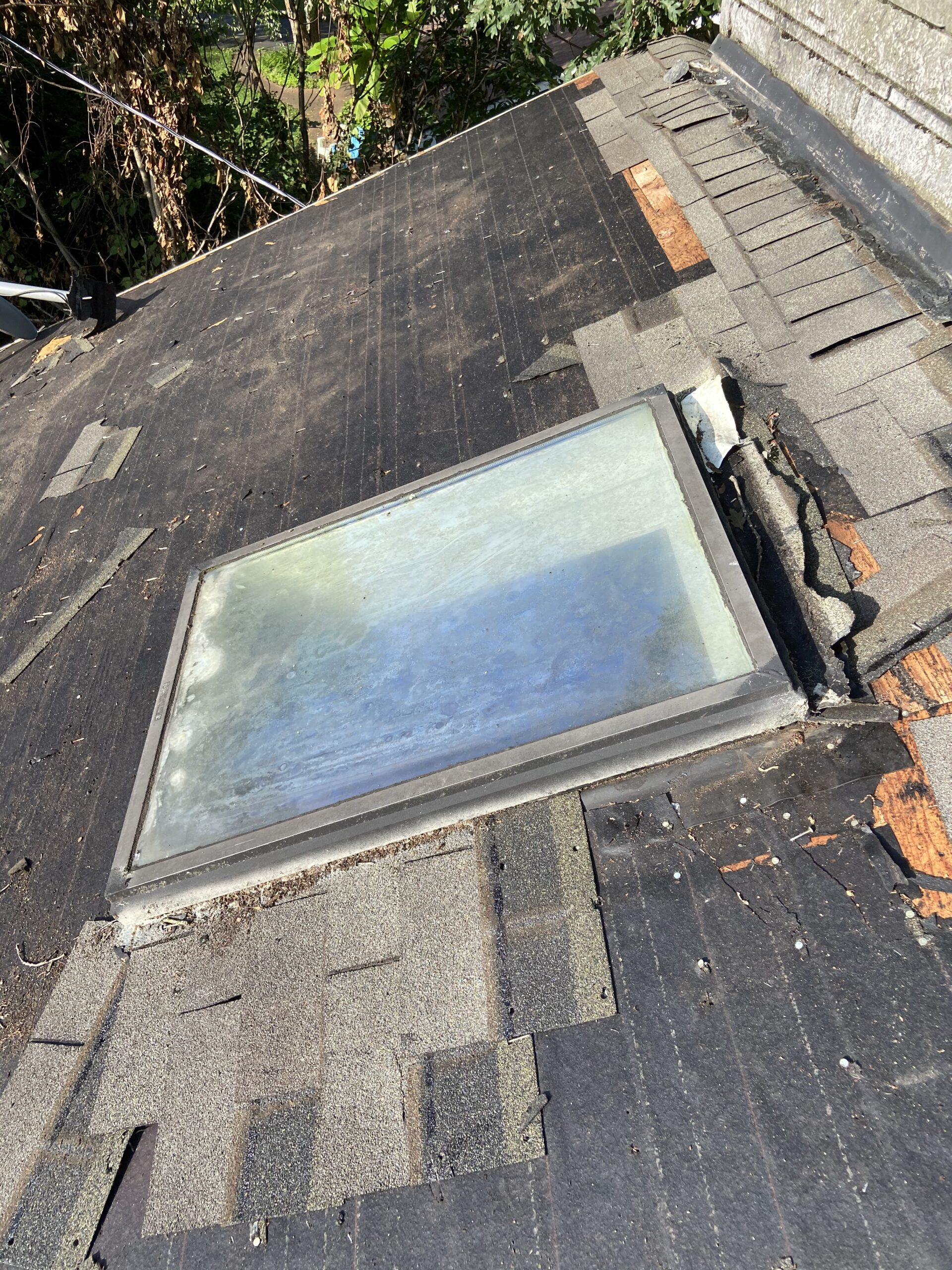 The skylight with all the shingles removed around it