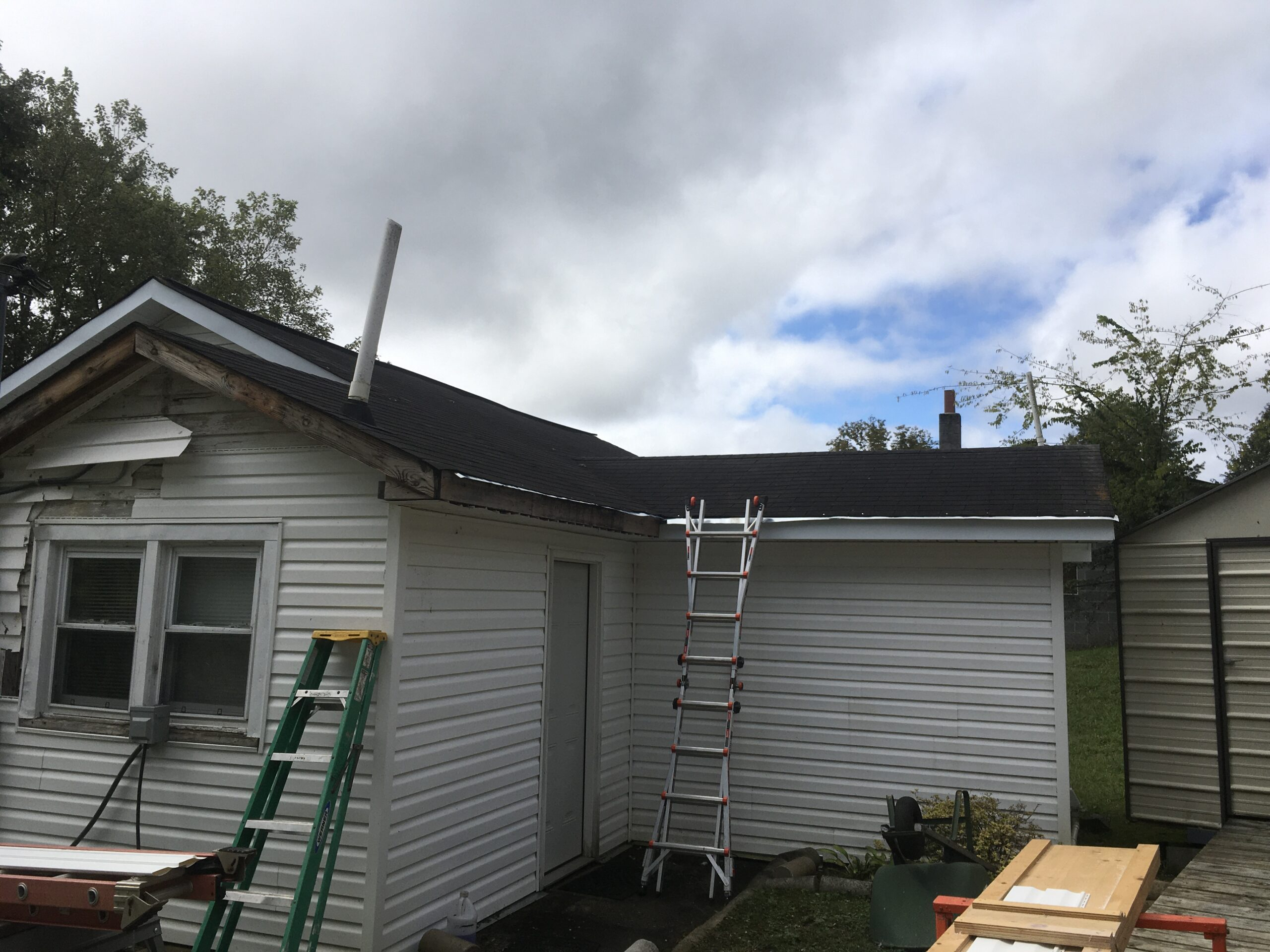 This is a picture of an old roof that needs gutters