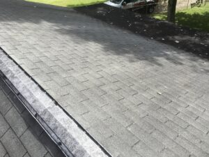 This is a picture of an old metal ridge vent an old three tab shingles