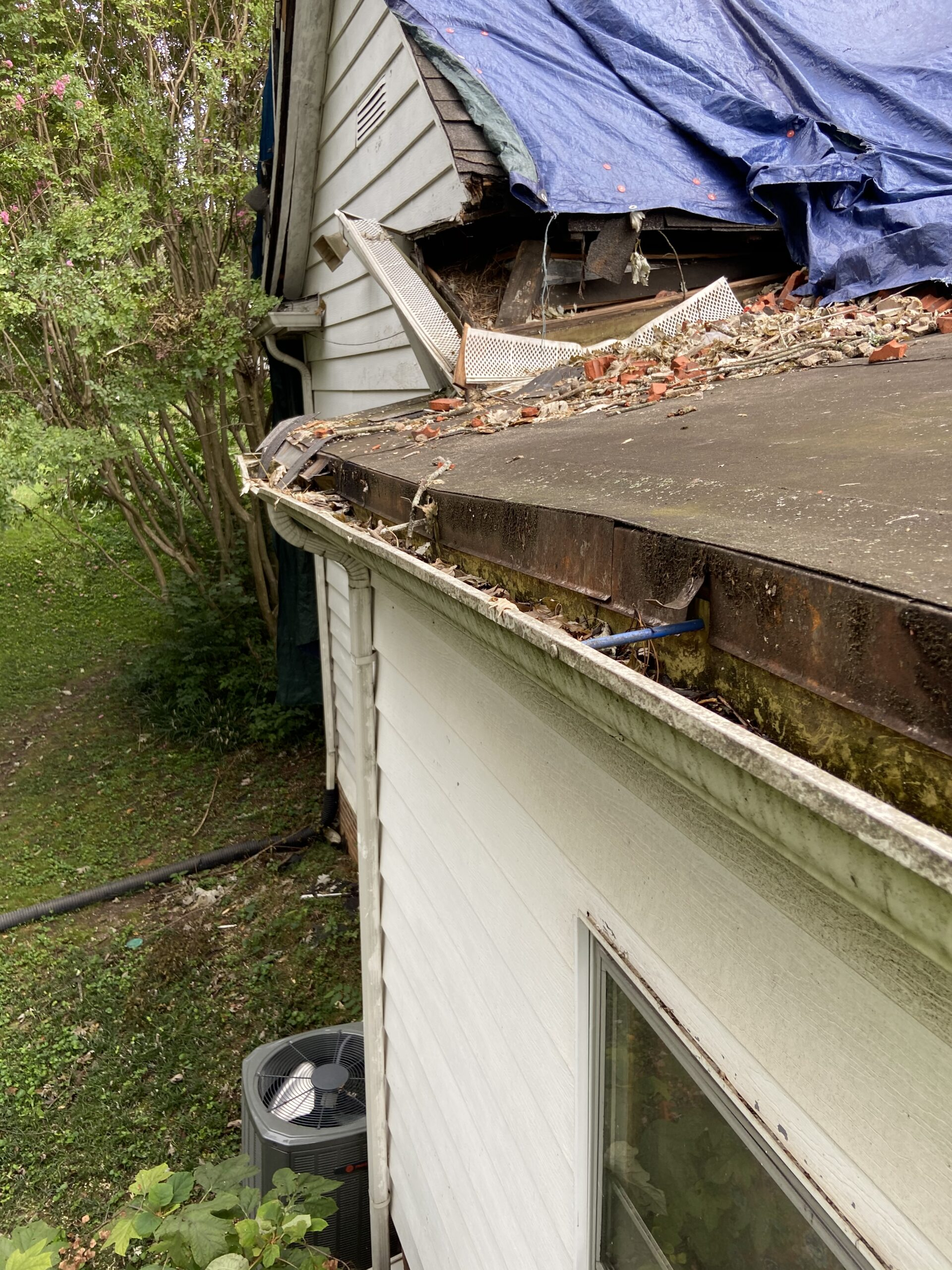 The roof eve was damaged by falling chimney