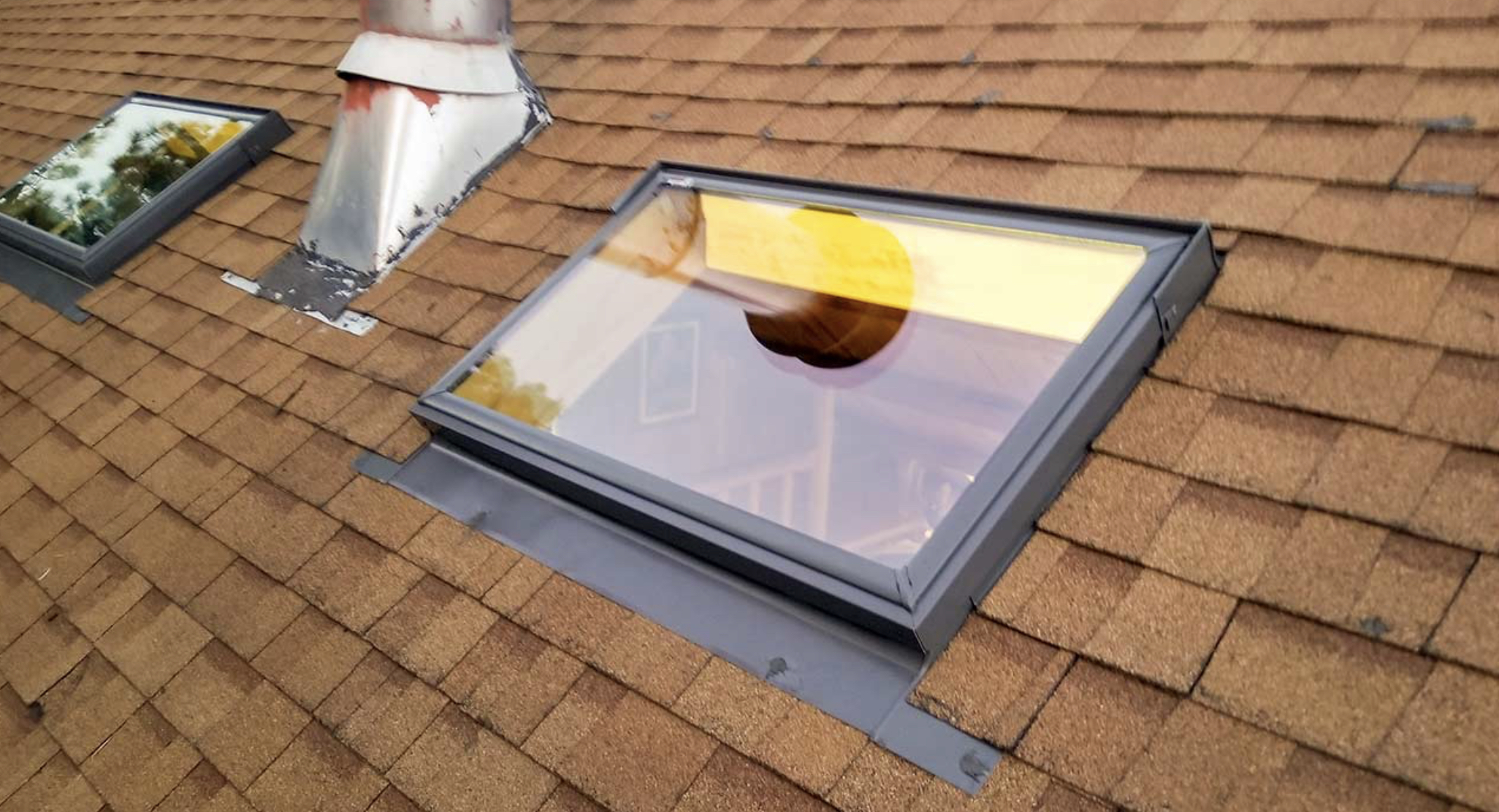 Deck mount skylight installed on an existing shingle roof. This particular example is a horizontal installation. This can be a little more expensive due to added framing