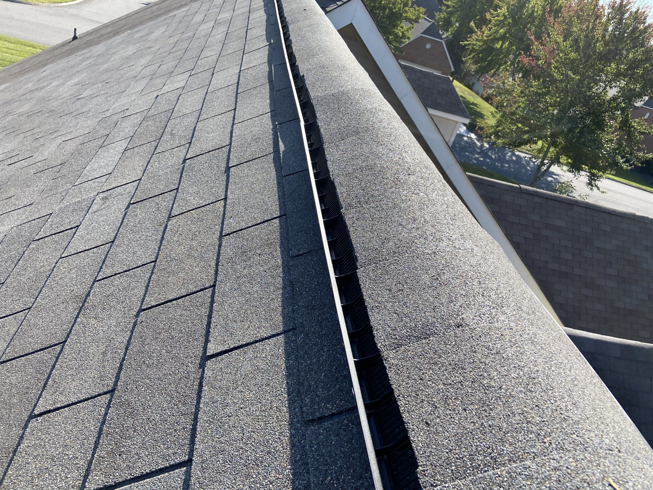 This is a picture of new ridge vent on a gray colored roof