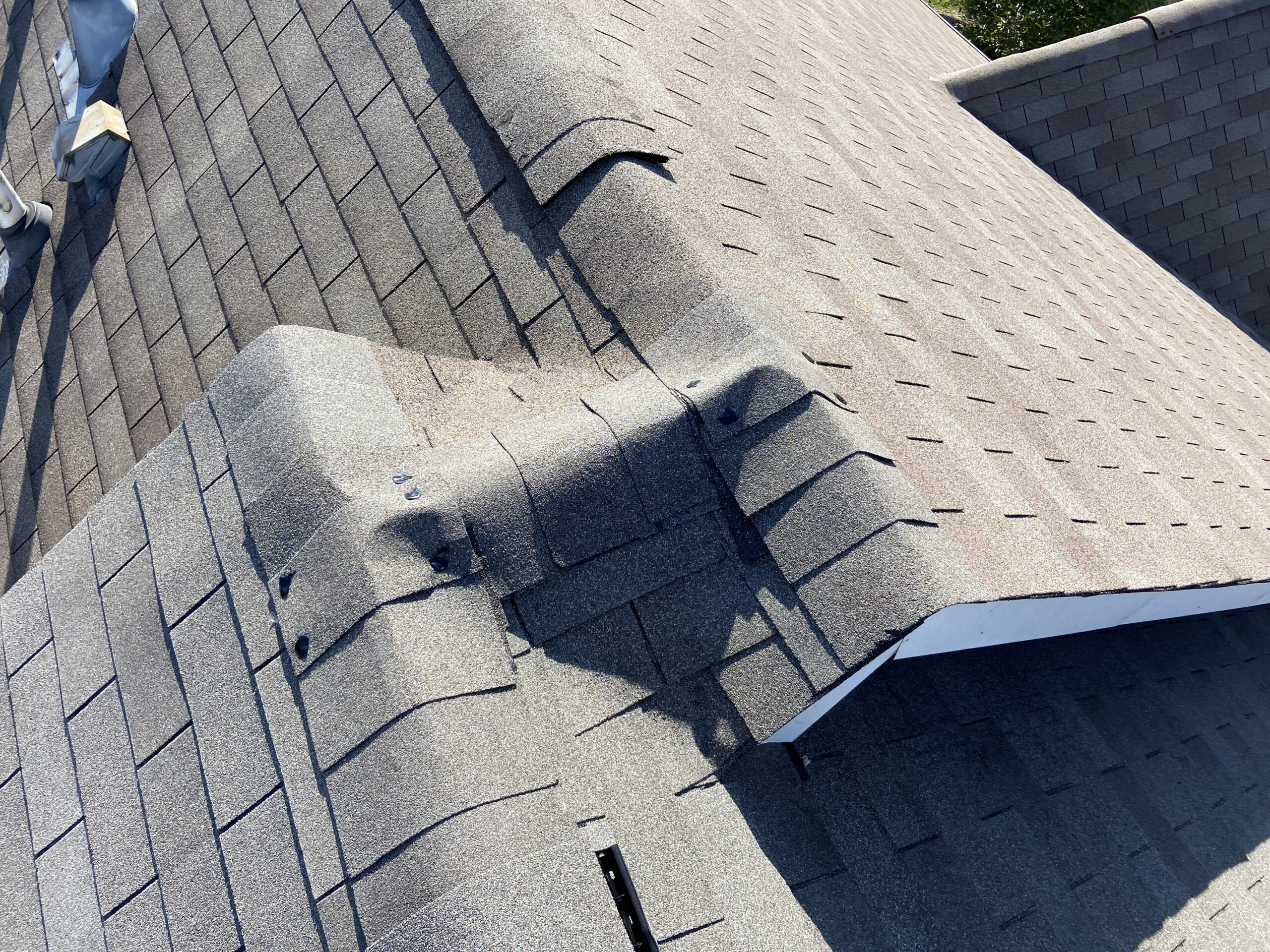 There's a picture of a condo roof tying into the Neighbor in Roof