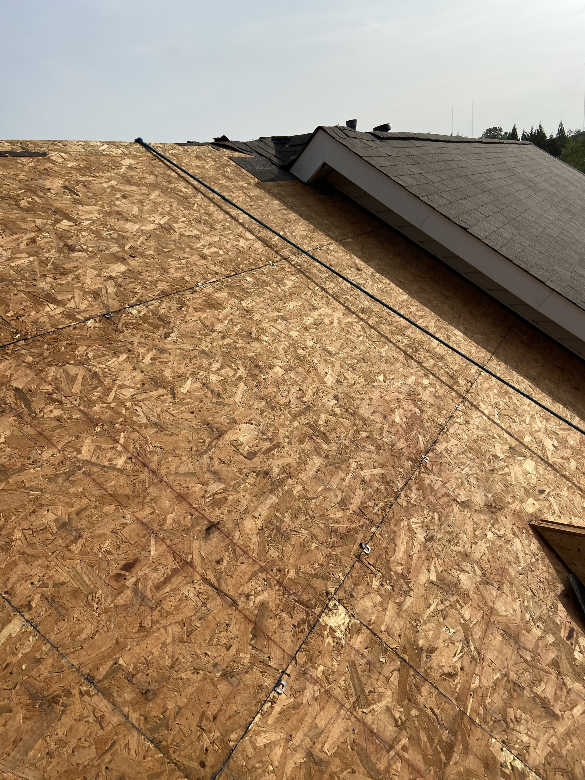 This is a picture of a roof deck and the OSB boards that will be underneath the shingles