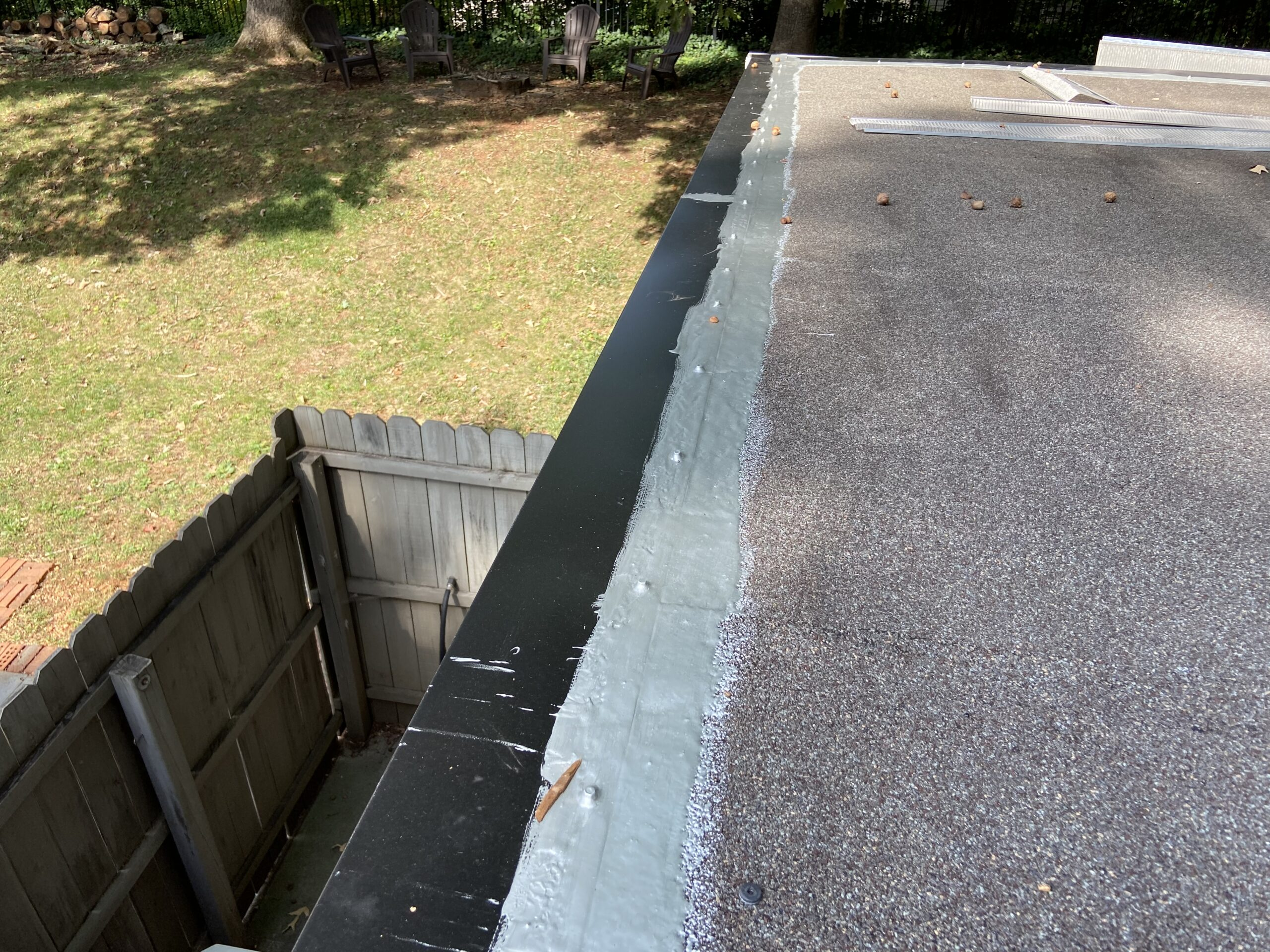 This is a commercial roof coating going over a commercial roof
