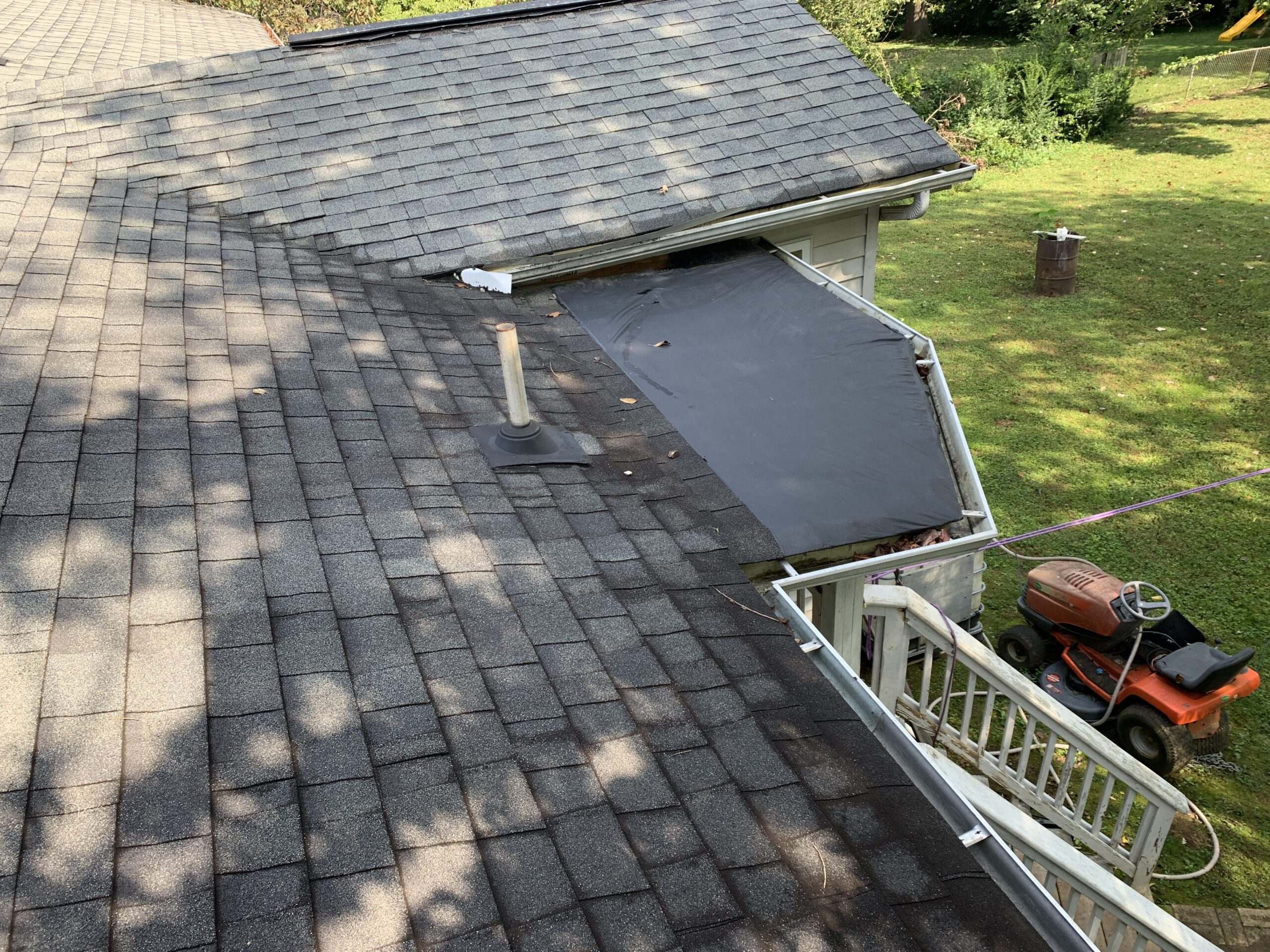 Improper flat roof membrane installation and improper framing and design lead to substantial water damage and rotten wood