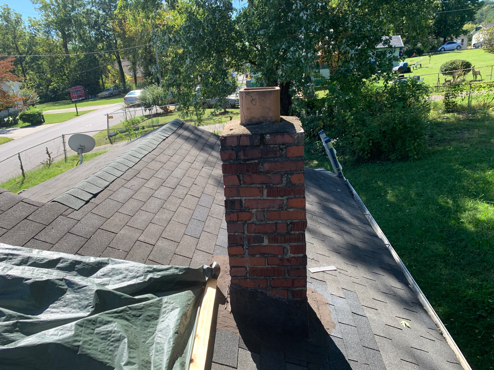 This is a view of the chimney and ridge of the roof.