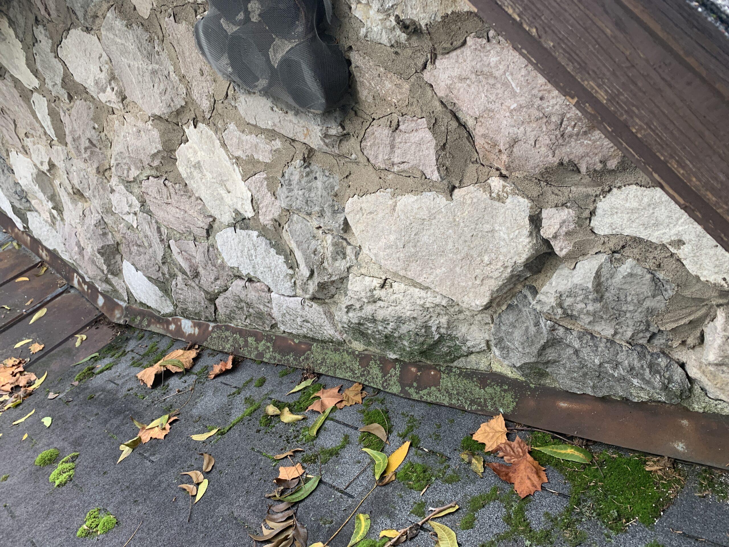 Bad wall flashing at shingle roof where it meets stone wall
