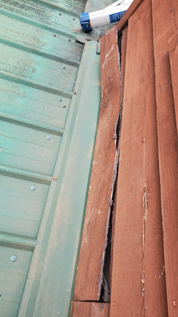 This is a picture of the wood siding that is cracked and pulling away.