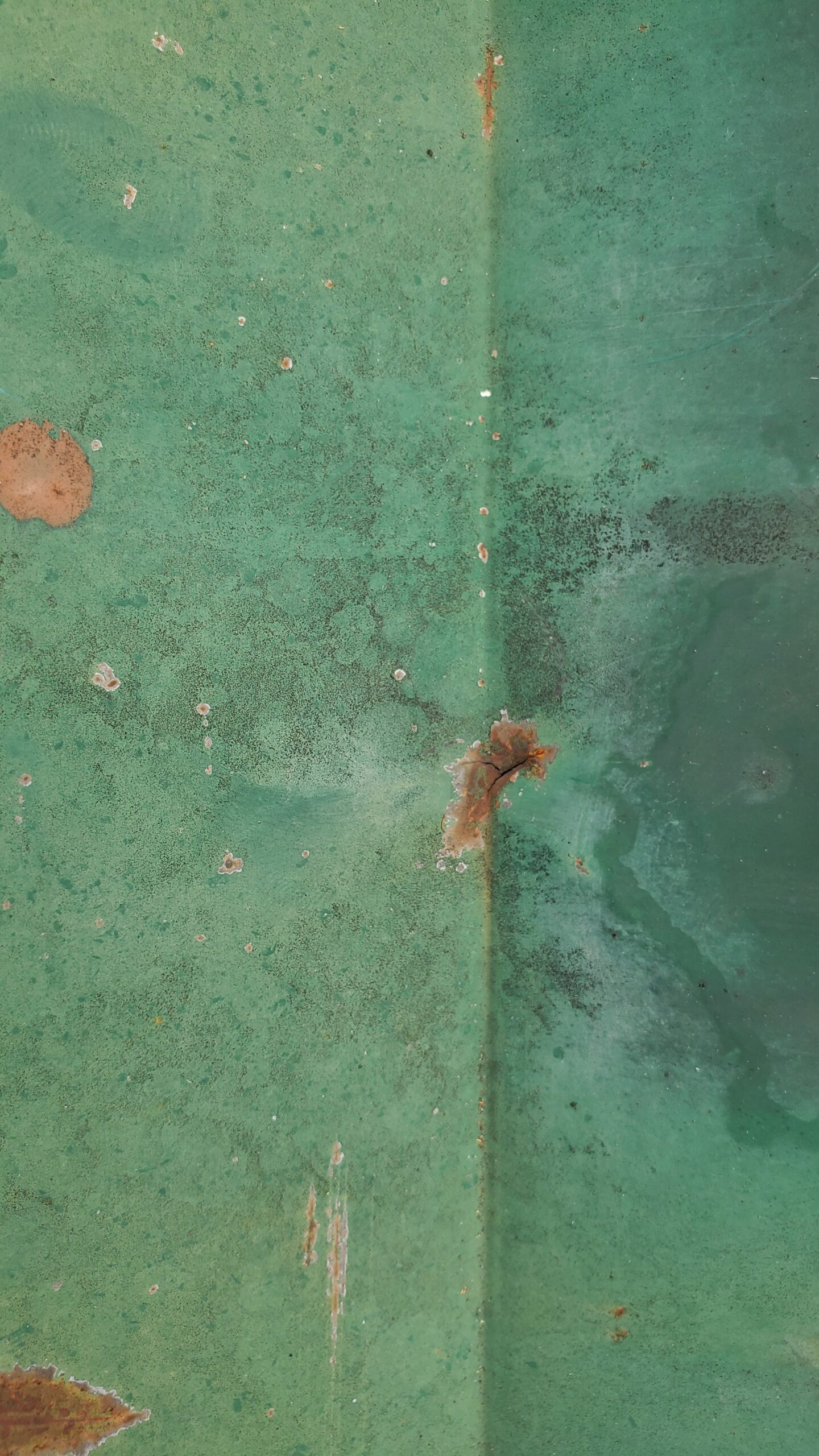 This is a picture of a metal roof panel with rust.