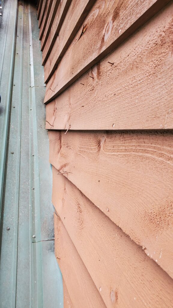 This is a picture of a the wood siding of the house.