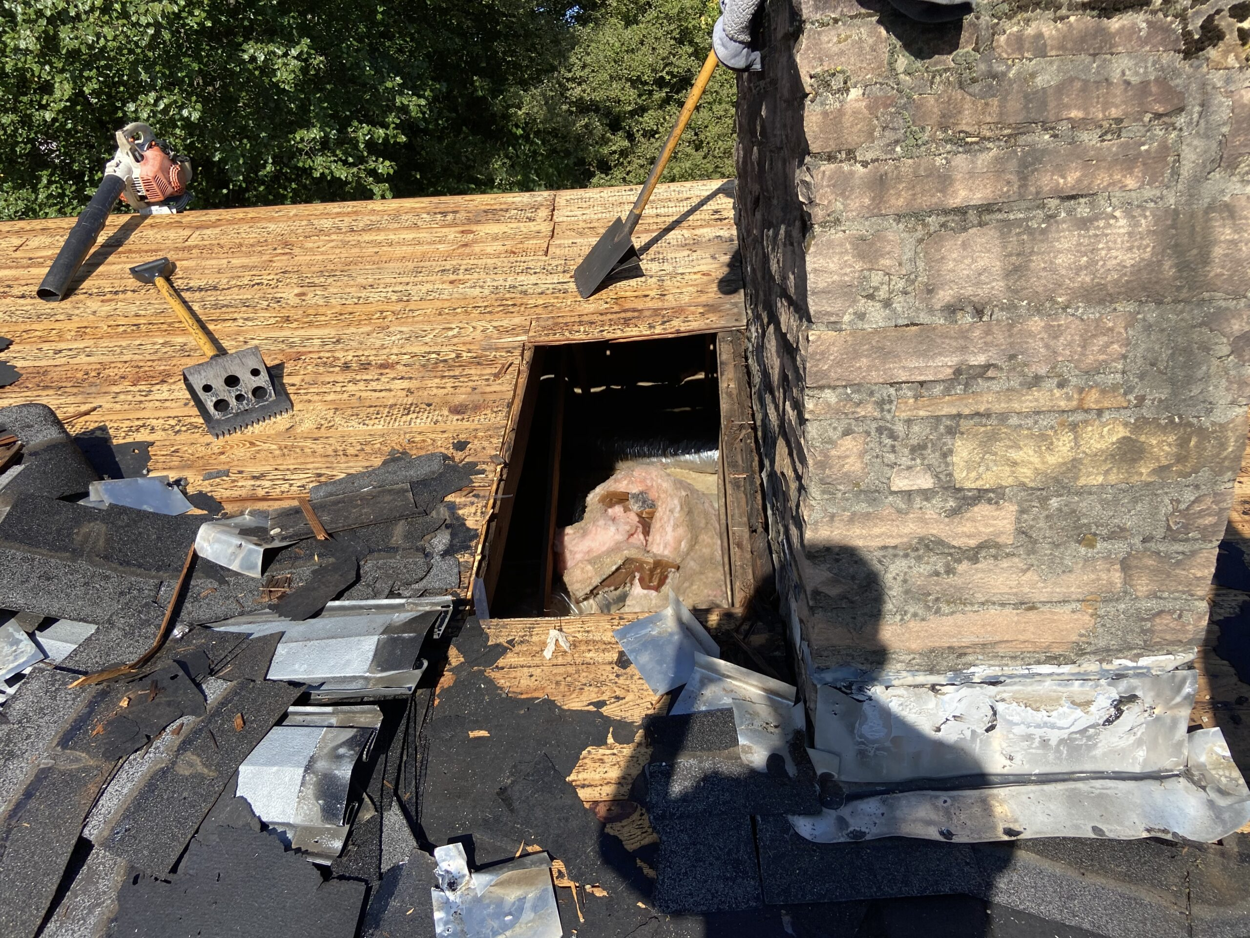 There's a picture of a hole in a roof near plywood chimney