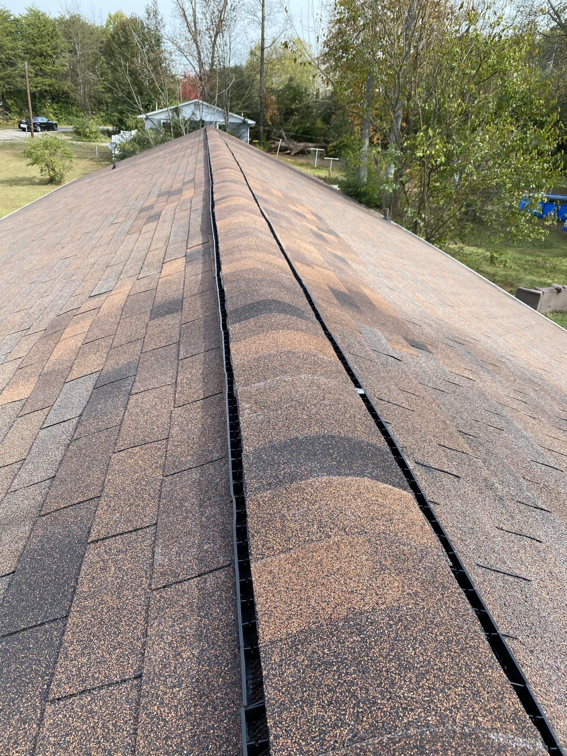 Replaced ridge vent And you can see that the new colored shingles are a great match here they are brown in color