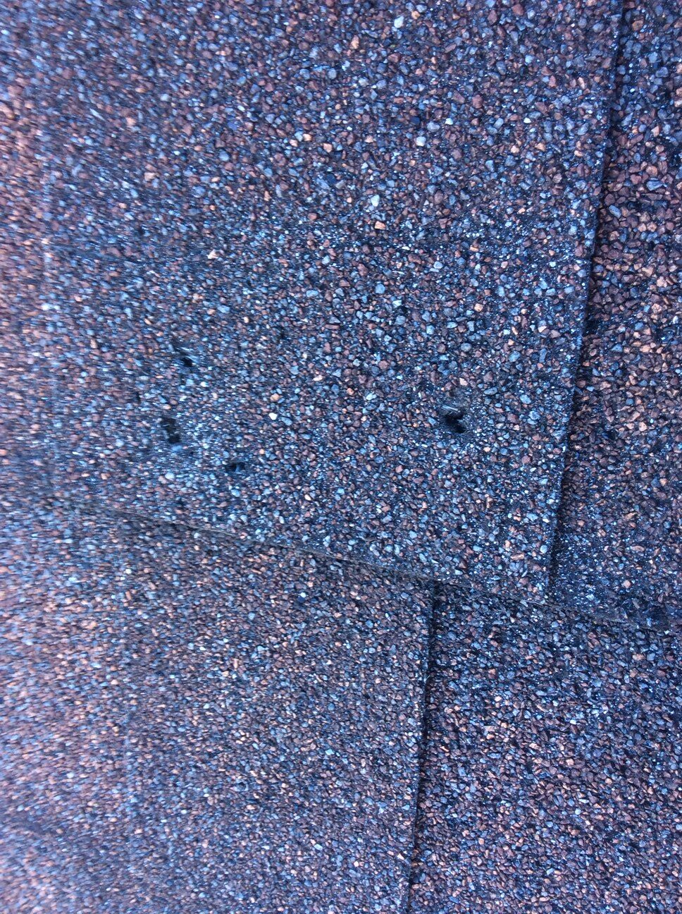 Theses are shingles that will need to be replaced. They have exposed holes..