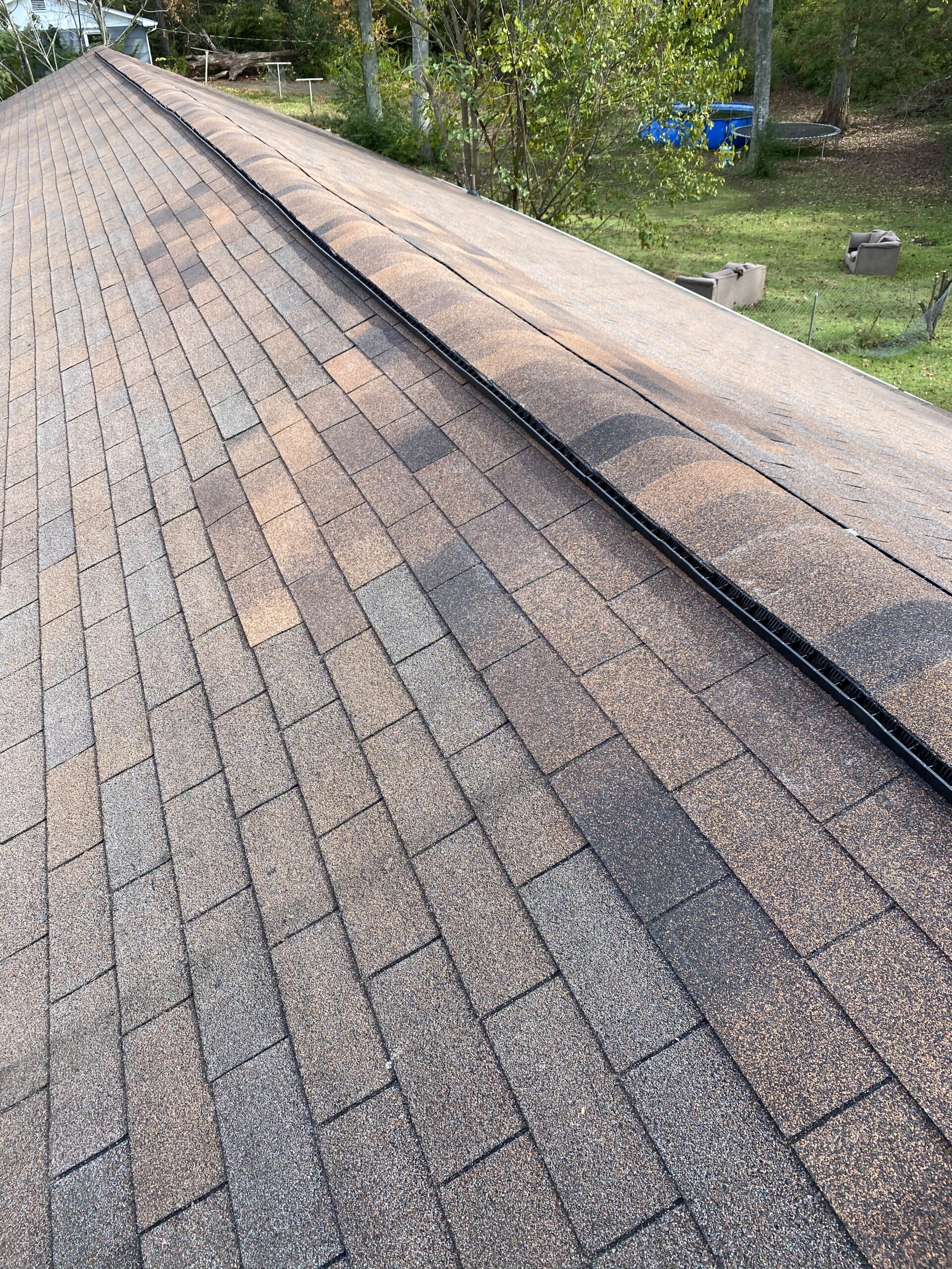 Replaced boards and ahingles at the ridge of the roof and there is a new ridge vent here