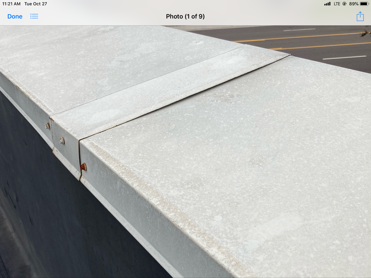 This is a view of silver metal curb on a commercial flat roof.
