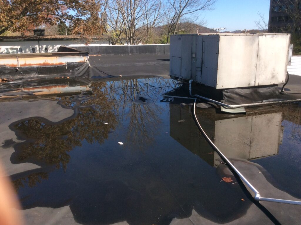 This is a view of a flat roof with ponding water.