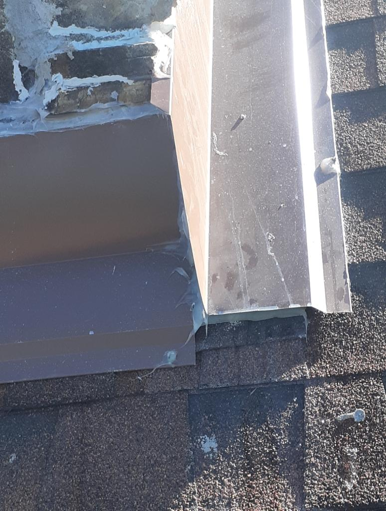 This is a picture of chimney flashing that is a big problem and causing roof leaks