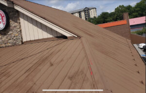 Old corrugated metal roofing with issues and peeling paint