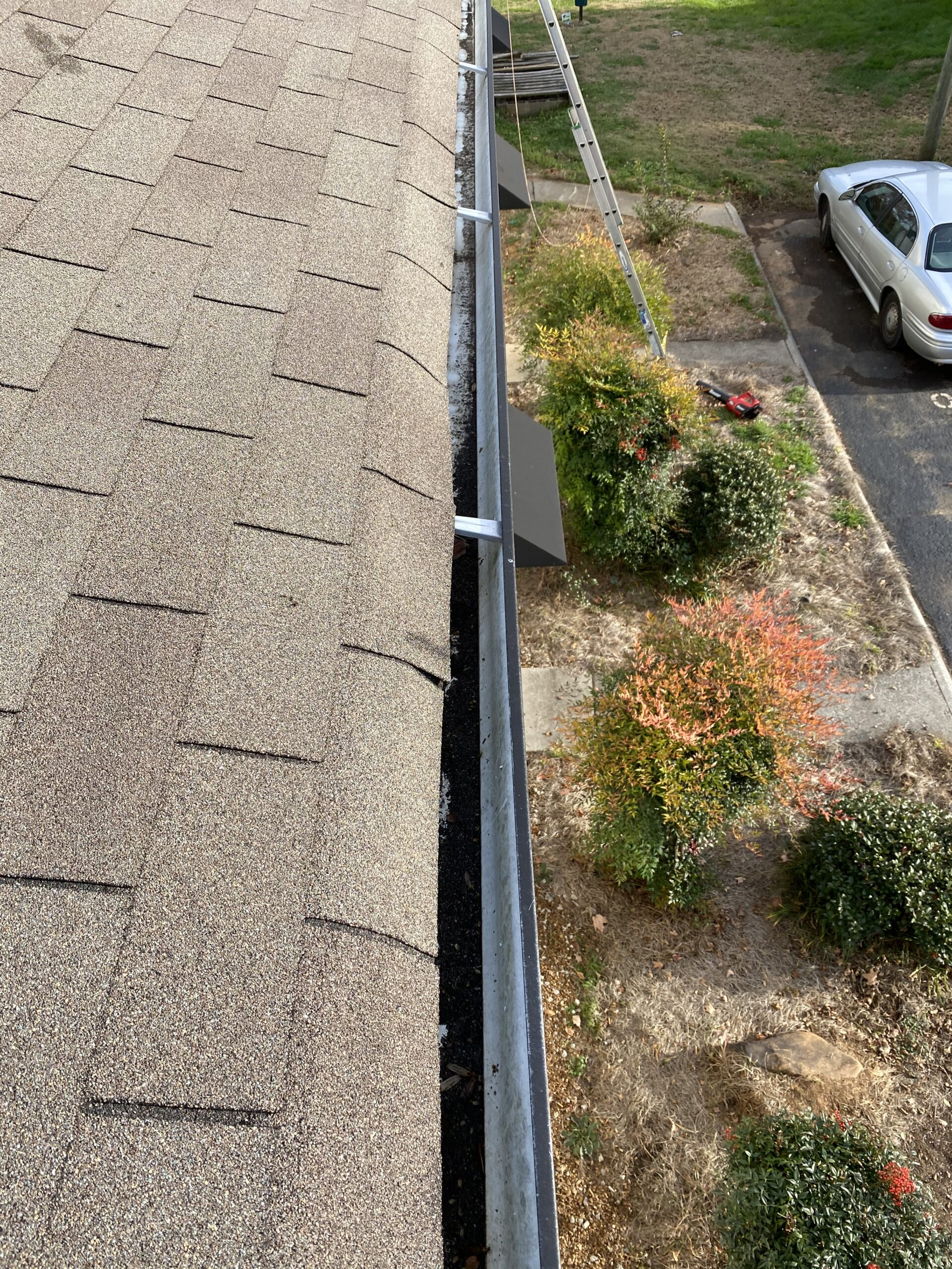 This is a picture of gutters that were cleaned out