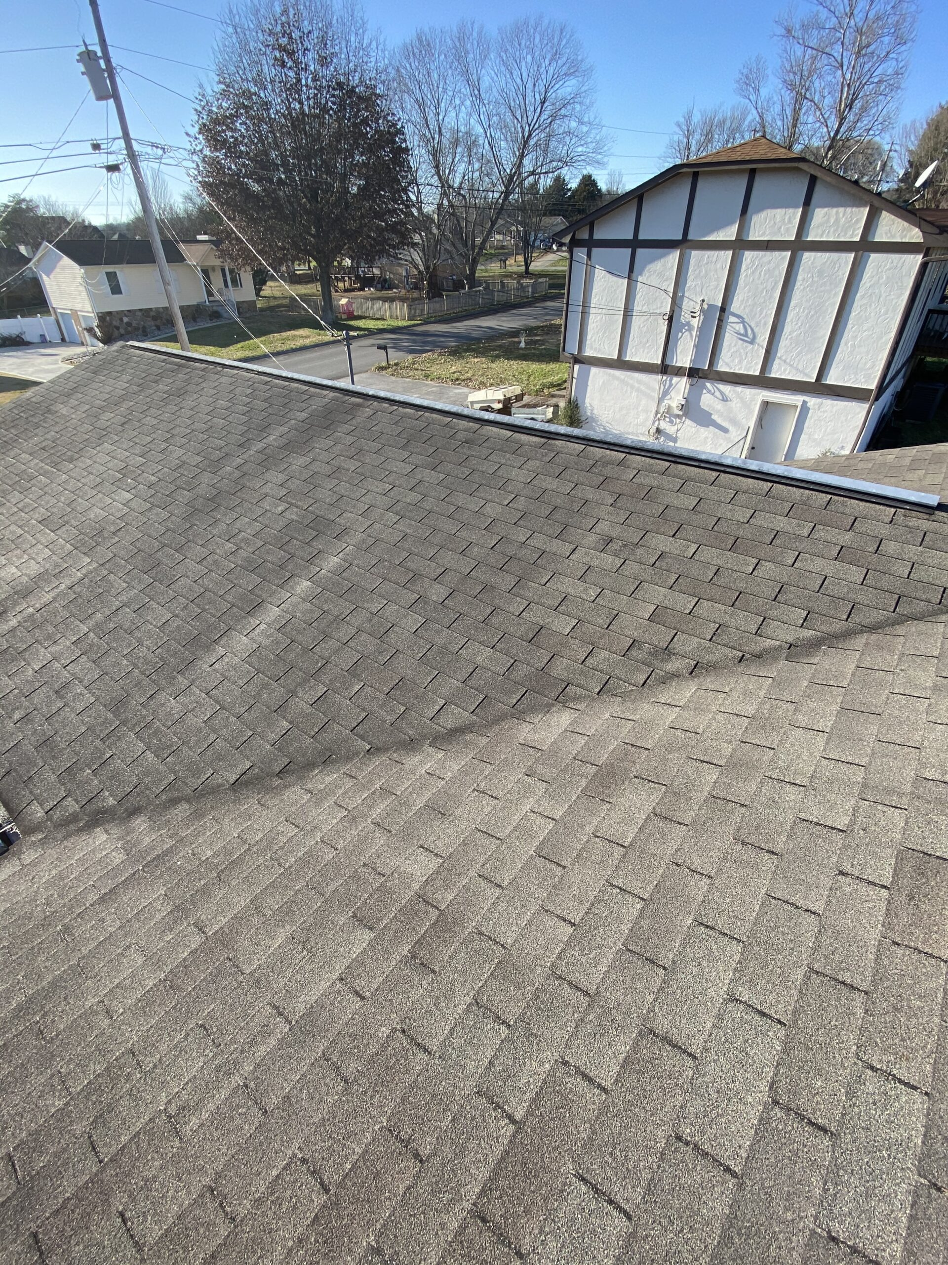 This is a picture of an old 3 tab roof that needs to be replaced