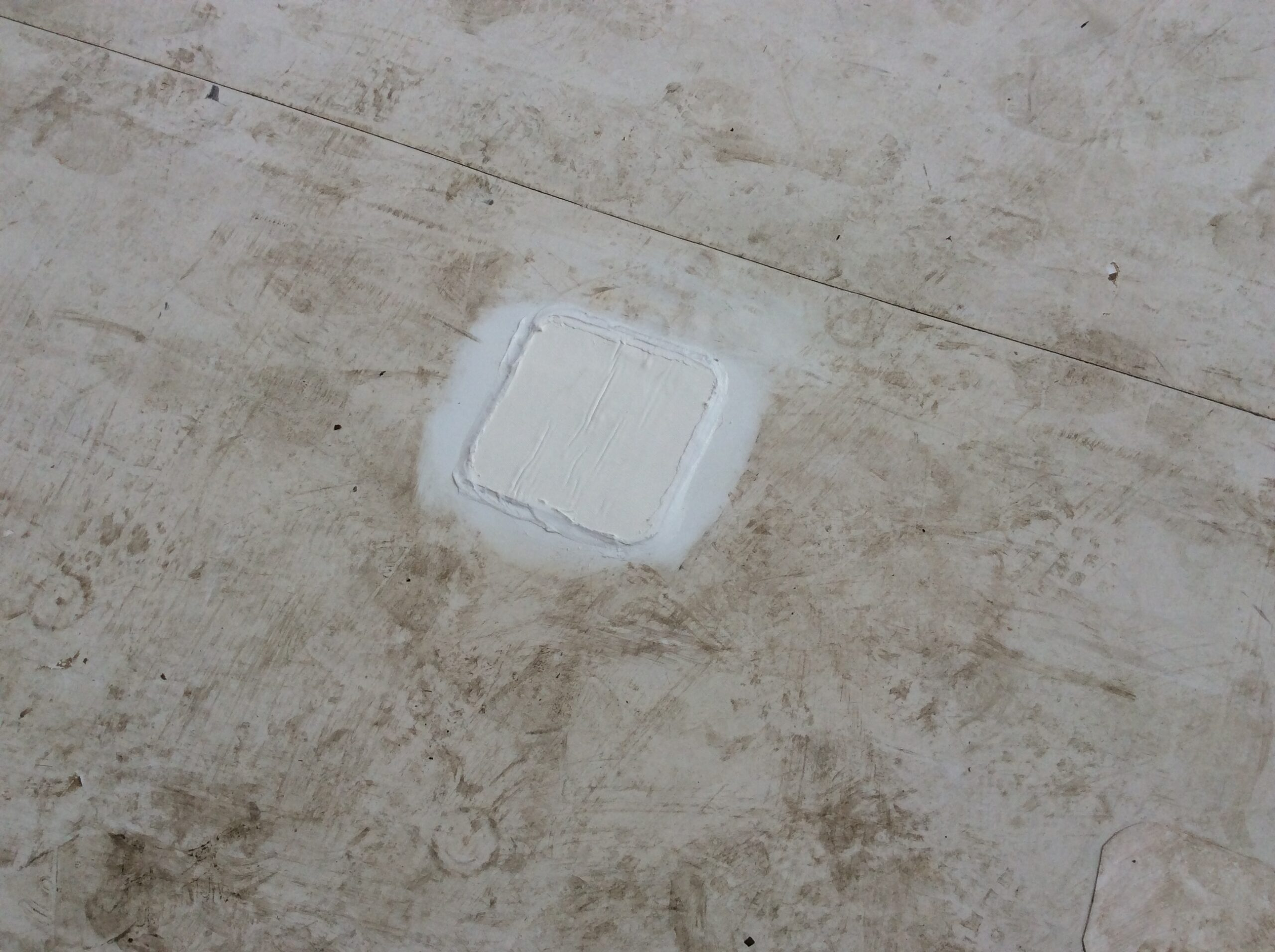 This is a picture of a patch that was done on a white flat roof.