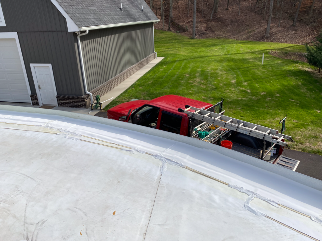 this is a picture of a white roof that is getting repair