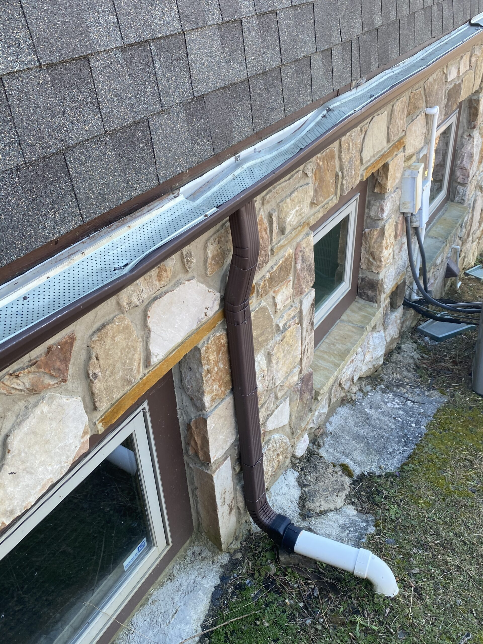 This is a picture of old gutters and gutter guards that need to be replaced