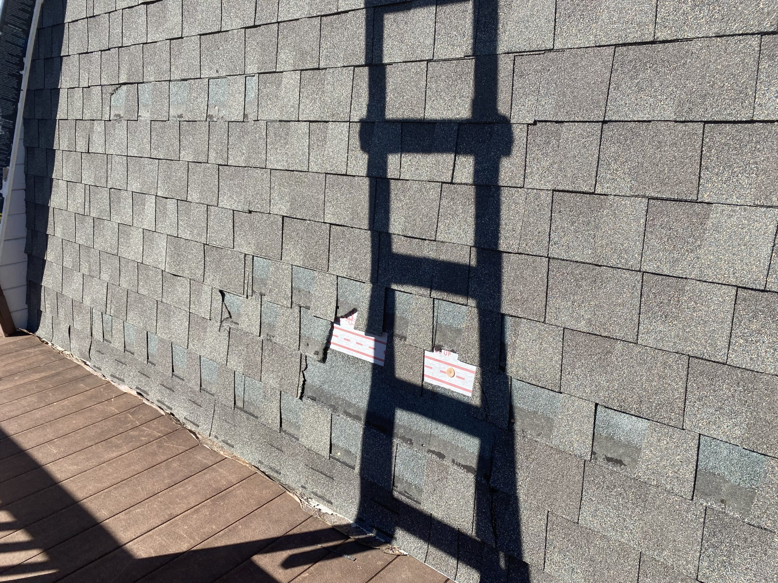 This is a picture shingles that have been damaged and torn off.