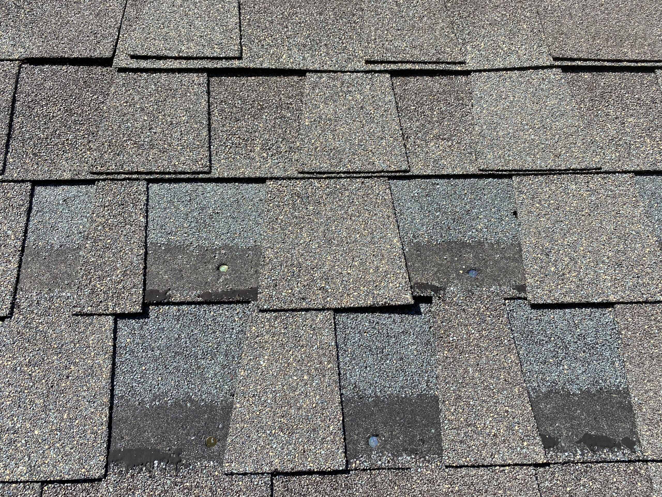 This is a picture of exposed nails on shingles.