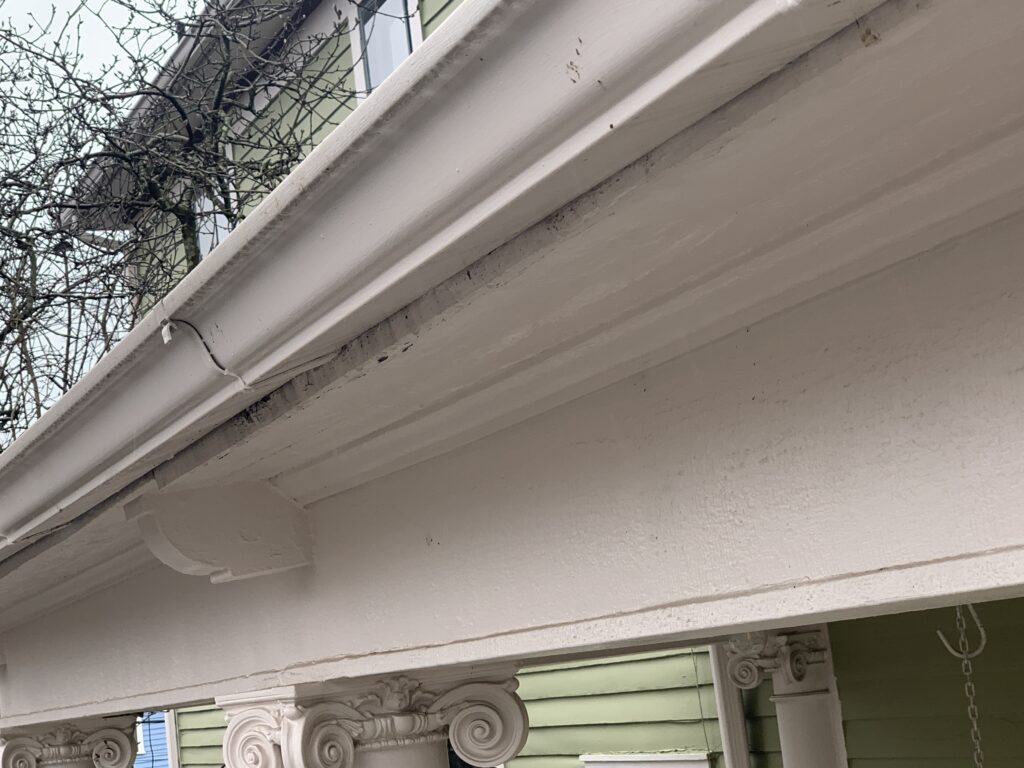 The facia board is being damaged by water caused from leaky and non-functional gutters and downspouts