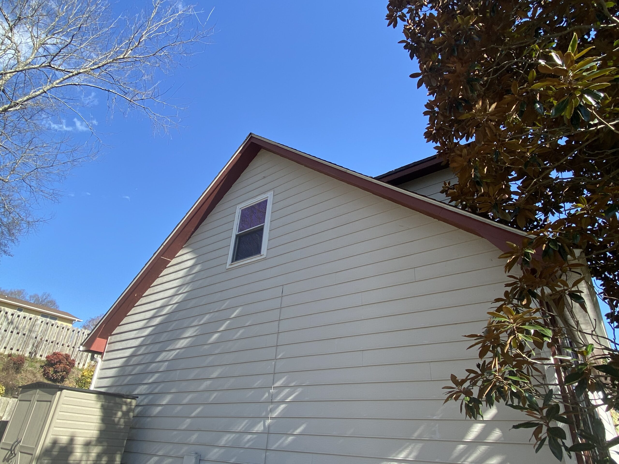This is a picture of a white home with red trim