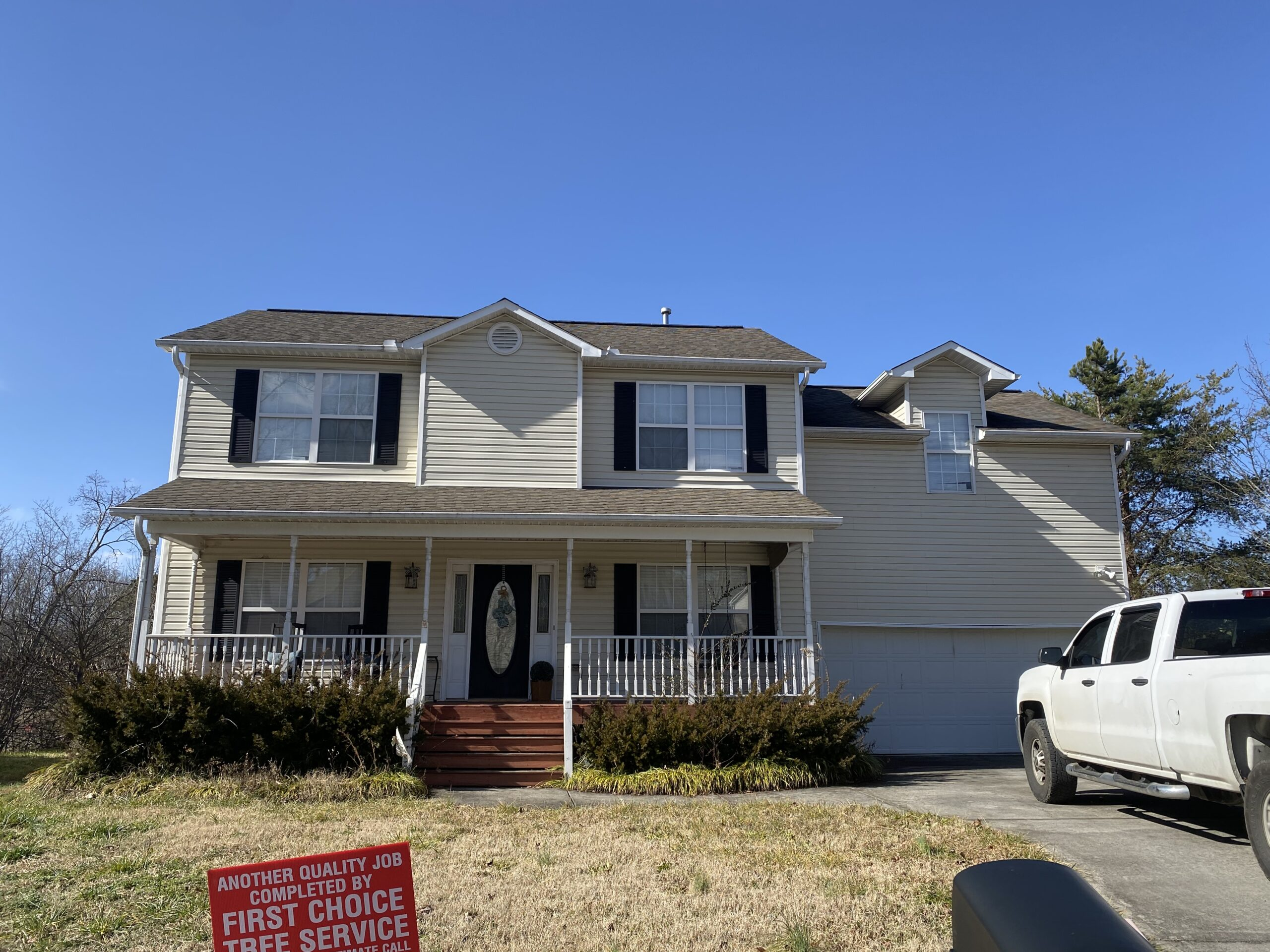 This is a picture of a two story white home with fascia damage