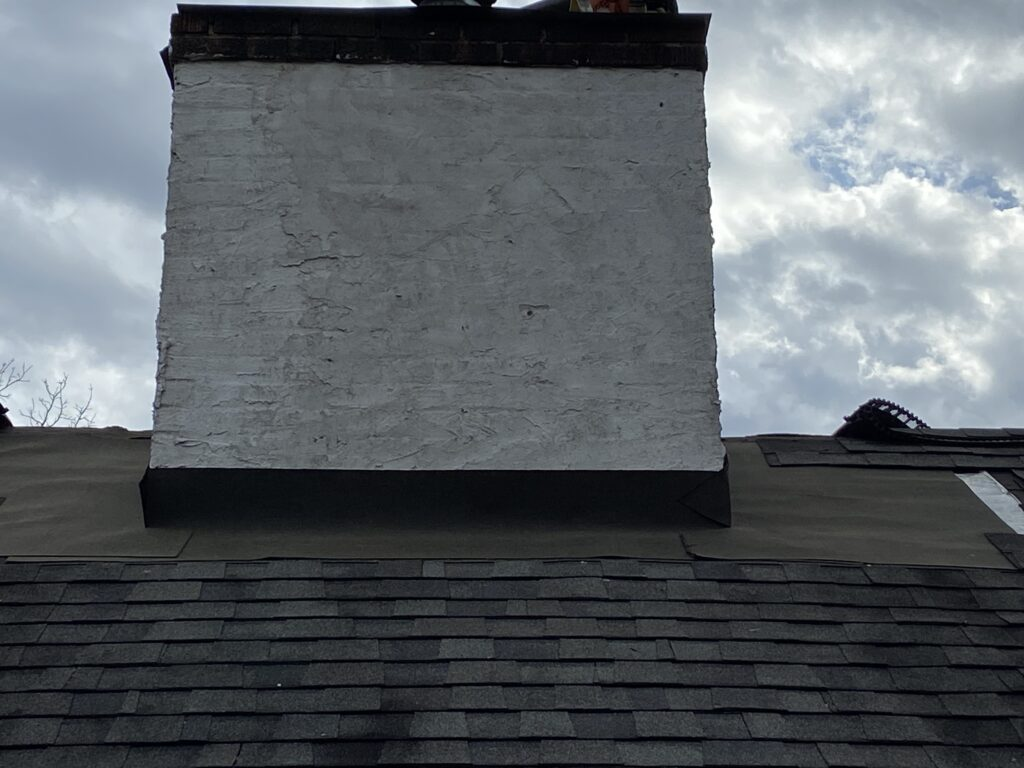 This is a picture of a chimney that has ice and water shield on it during construction