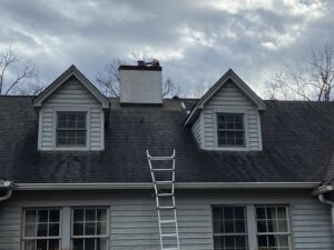 This picture shows a home that is getting a chimney reflashed because of roof leaks in Knoxville Tennessee