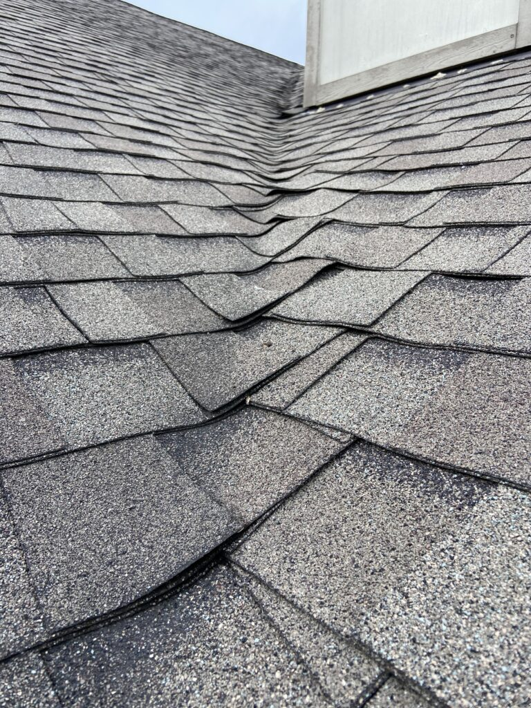 This is shingles of a valley that are starting to buckle