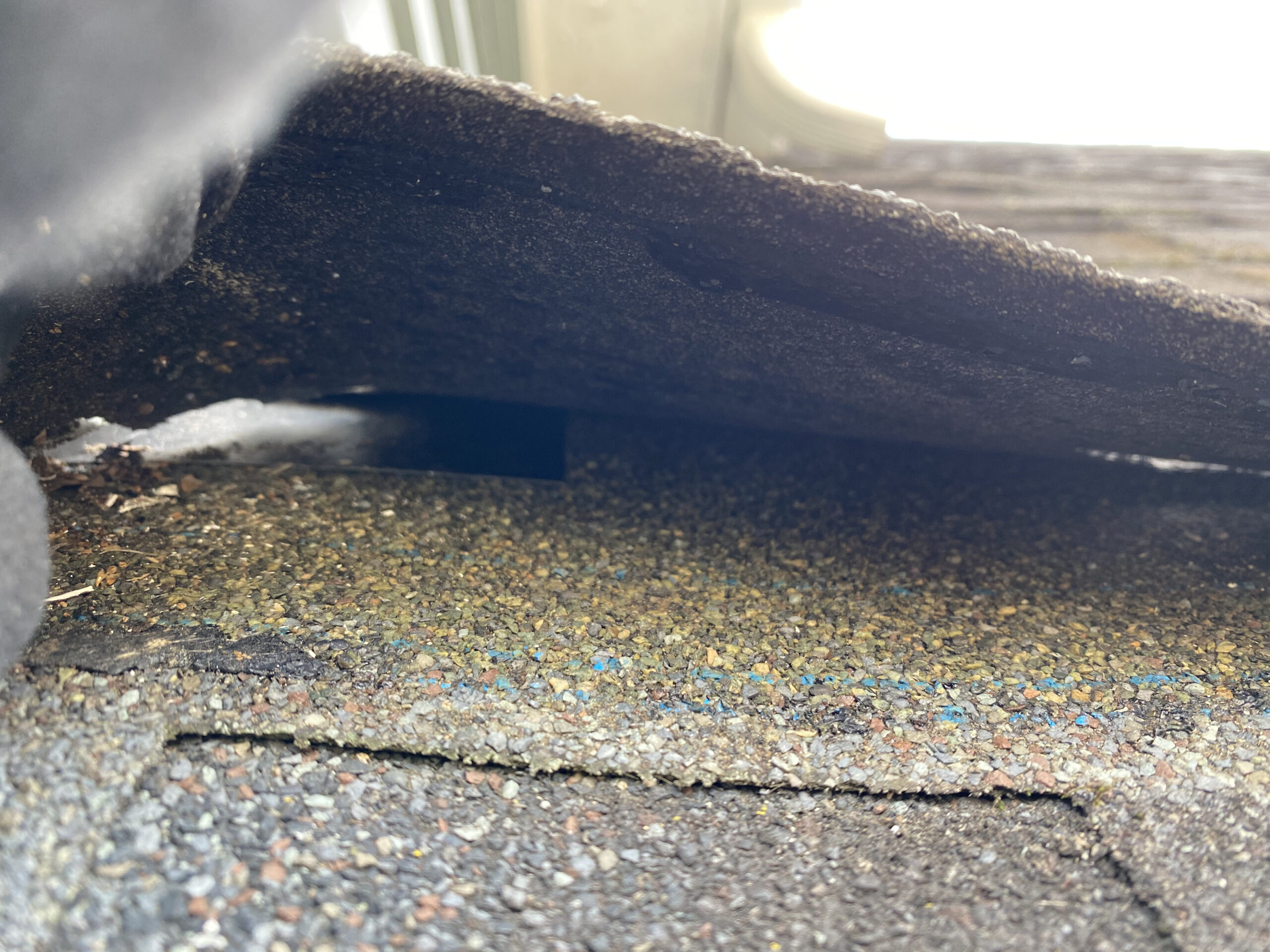 This is a picture of black step flashing underneath the shingles