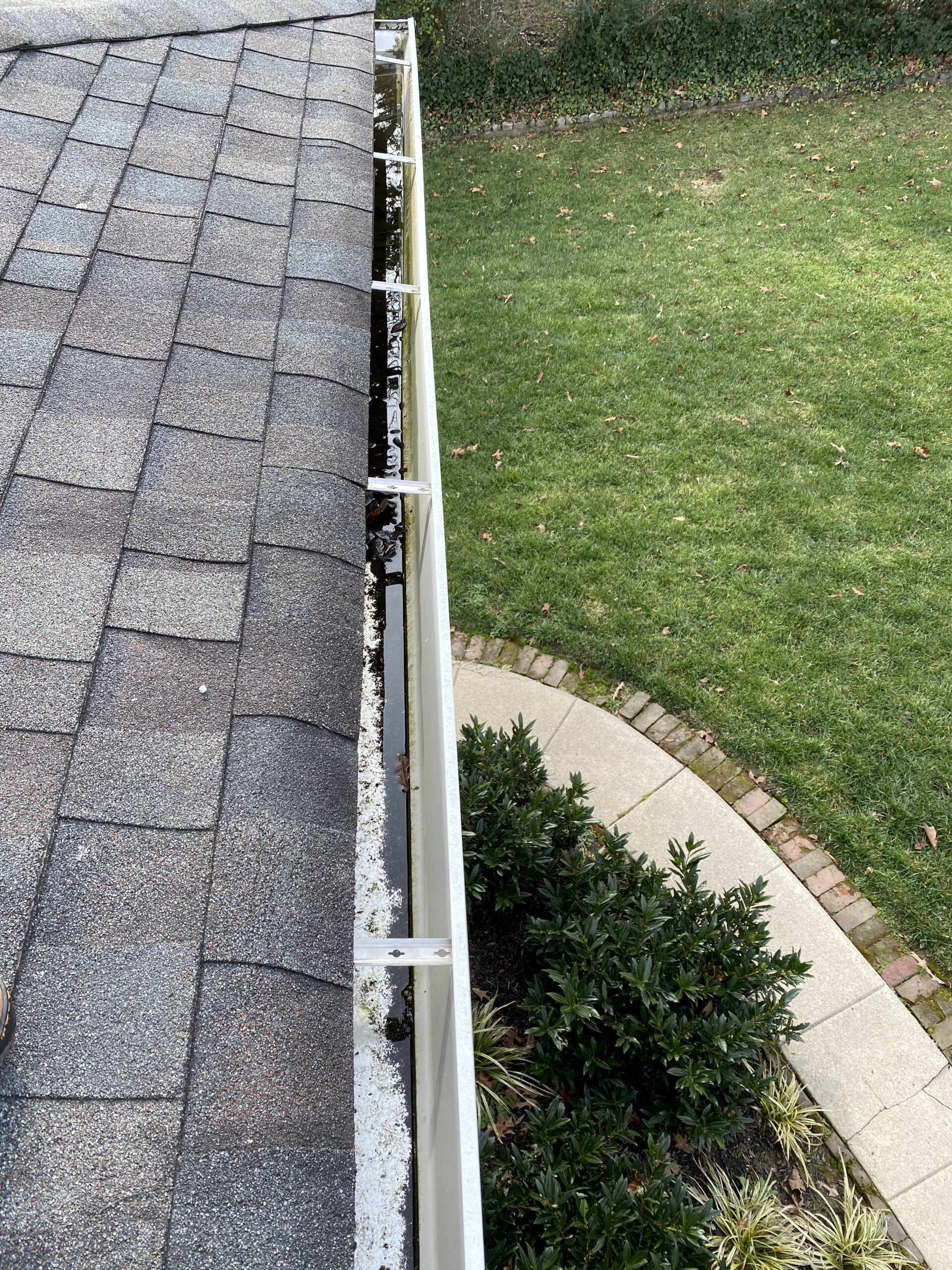 This is a picture of a white gutter that is holding water