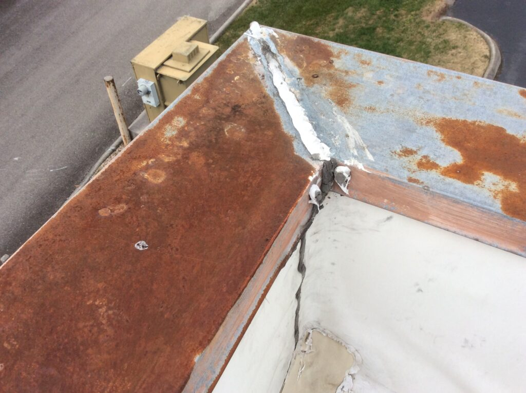 This is a view of the corner of wall of a commercial TPO roof.