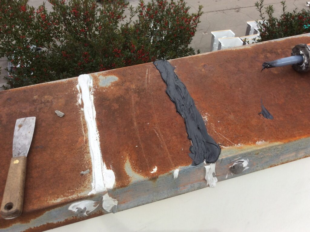 This is a view of the edge of the roof where we caulked the laps of the metal.