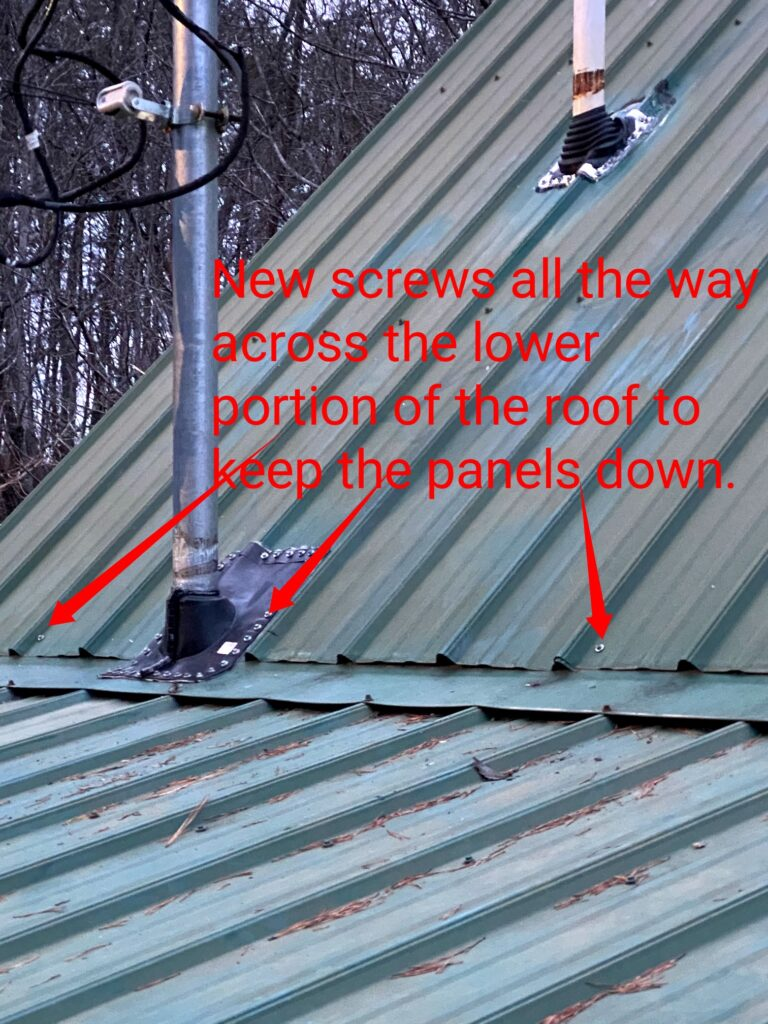 This is a picture of a green metal roof with red writing on the picture