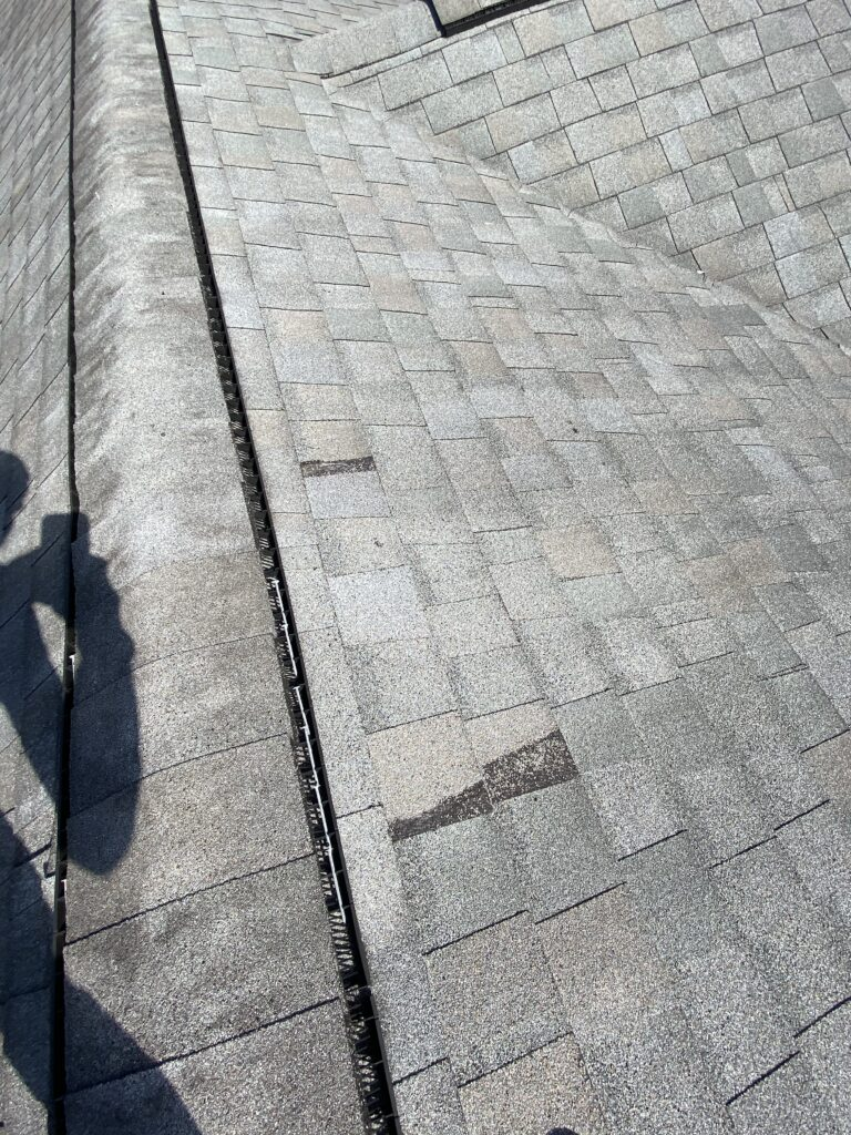 This is a picture of an old gray roof with missing shingles