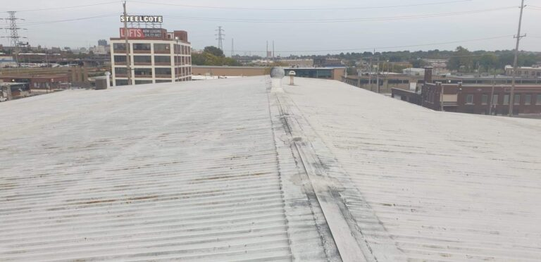 This is a picture of a metal roofing deck that has roof coating that's about to go on