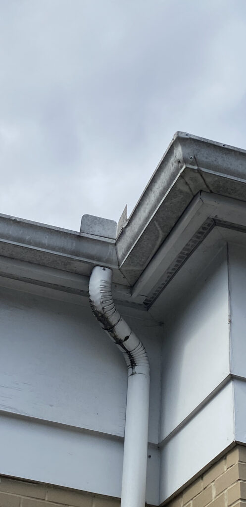 These gutters and facia show signs of leaking and malfunctioning