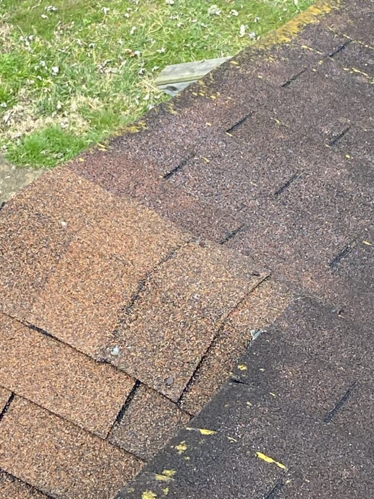 This is a picture of old brown ridge cap shingles with exposed nails