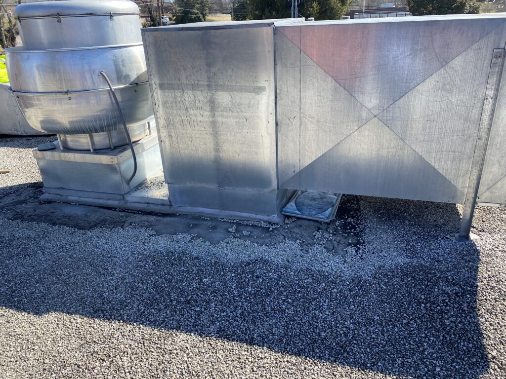 This is a picture of an hvac unit on top of a commercial flat roof