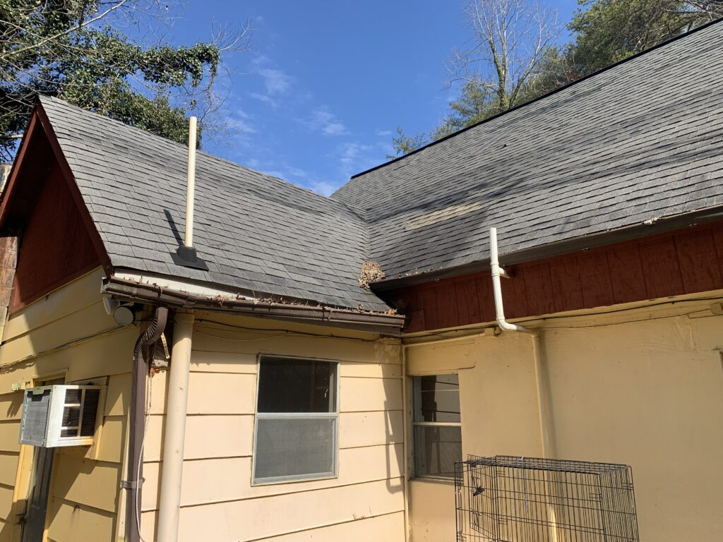 Some areas of this architectural shingle roof have been visibly repaired or replaced