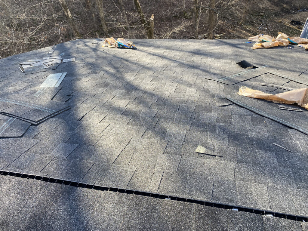 This is a picture of a charcoal black shingle on a roof installation