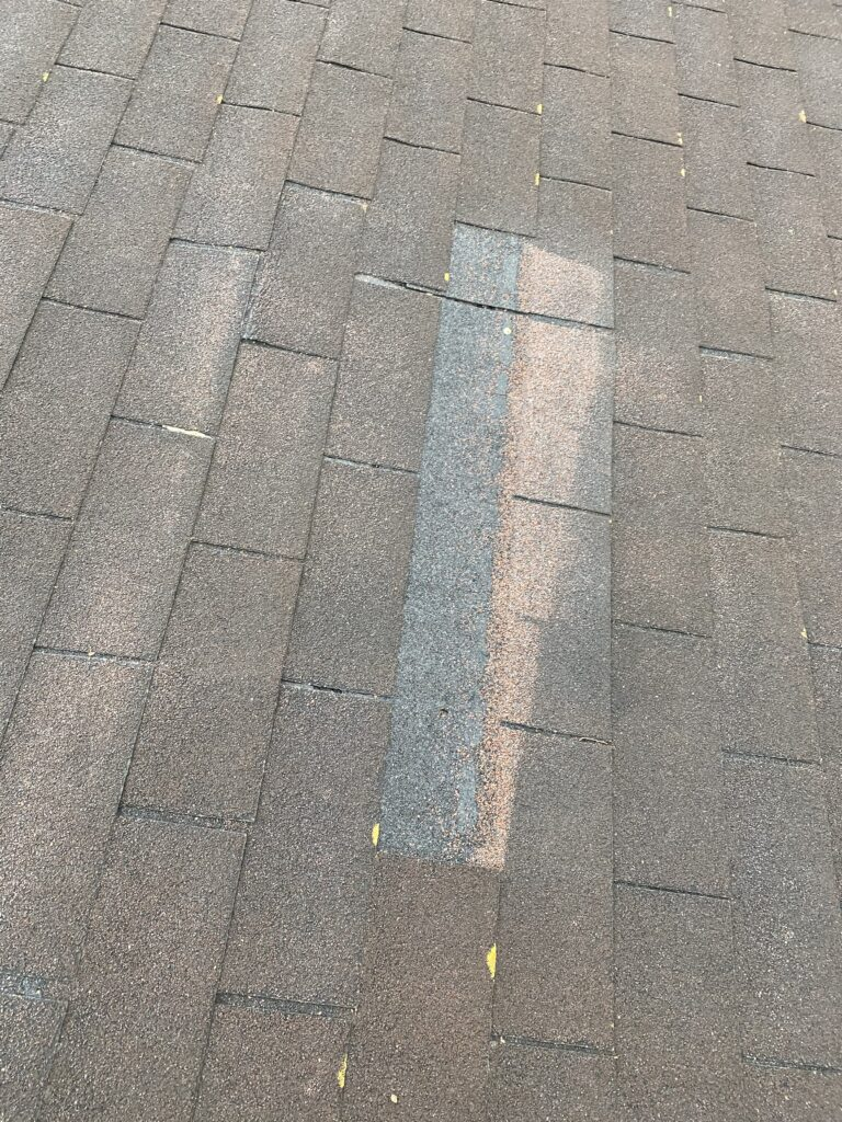 This is a picture of an old three tab roof with missing shingles