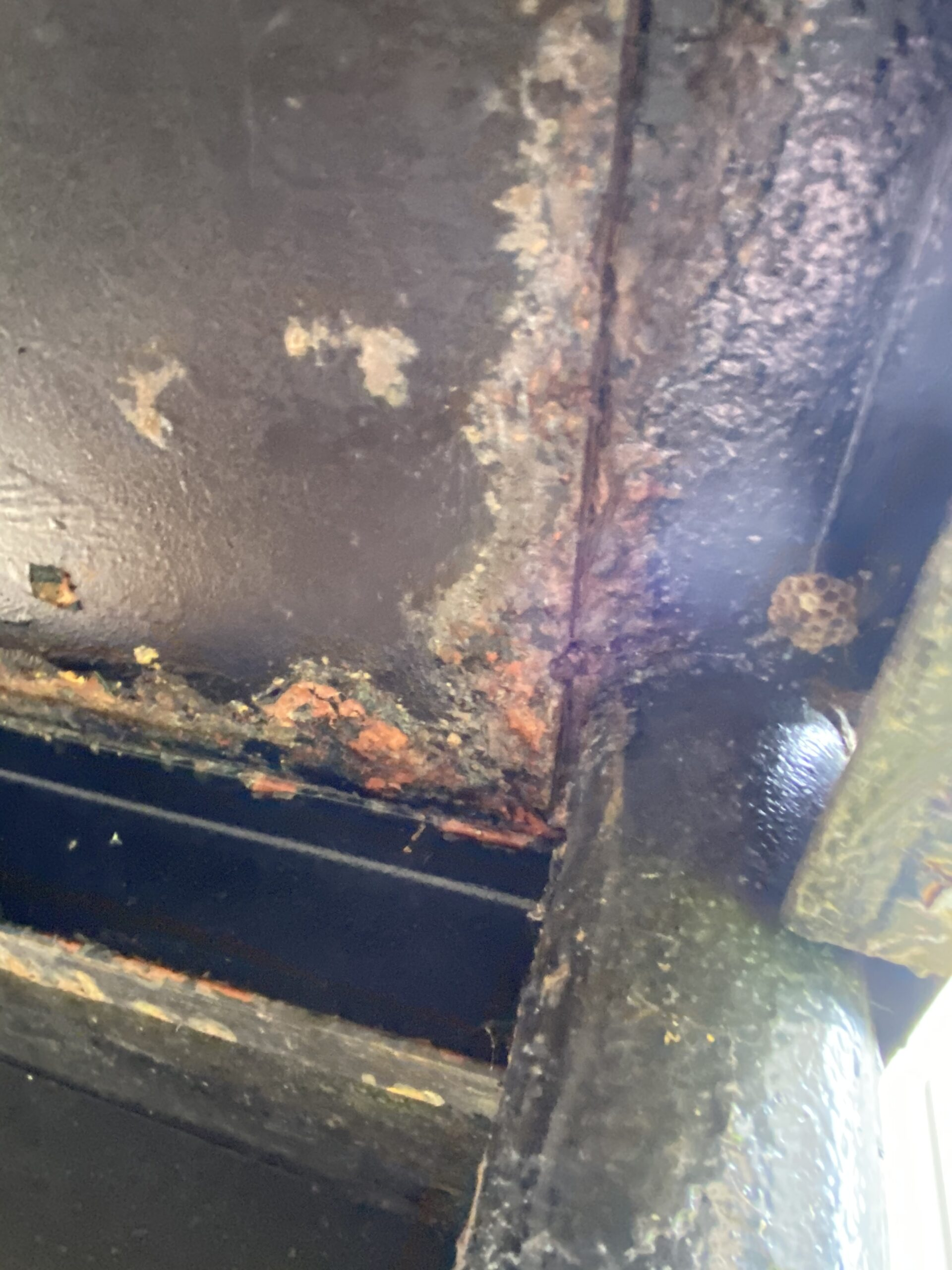 This is a picture of some rust on steel stairwells